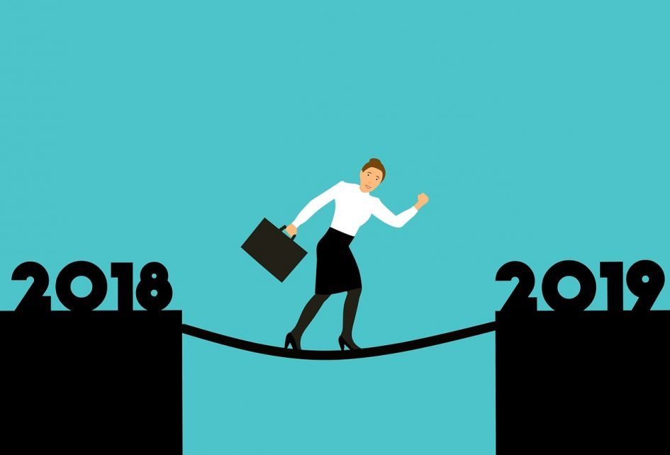 Image from Pixabay depicting a woman walking across a tightrope from 2018 to 2019. Link to original image: https://pixabay.com/en/design-2019-2018-to-reach-new-year-3754328/